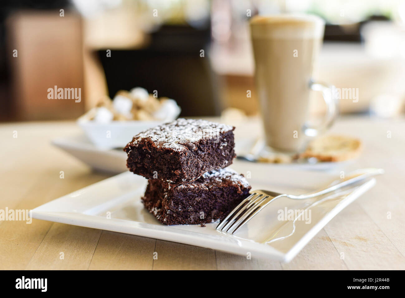 Food Two Chocolate Brownies Dessert Pudding Sweet Treat Chocolate brownies Baked Baking Fork Plate - Stock Image