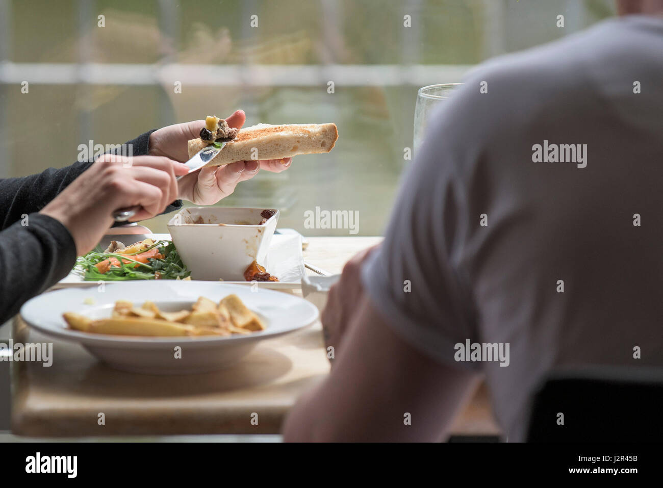 Restaurant Dining Diners Food Meal Customer Eating Enjoying a meal - Stock Image