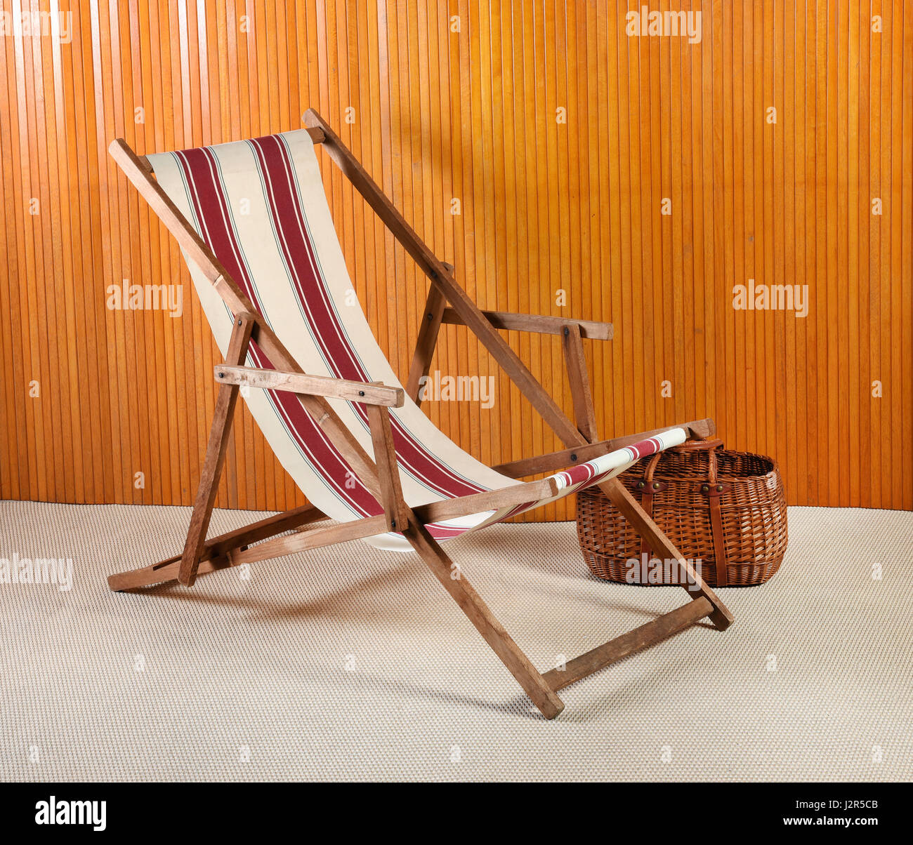 Amazing Side View Of Striped Canvas Deck Chair And Wicker Basket In Gmtry Best Dining Table And Chair Ideas Images Gmtryco