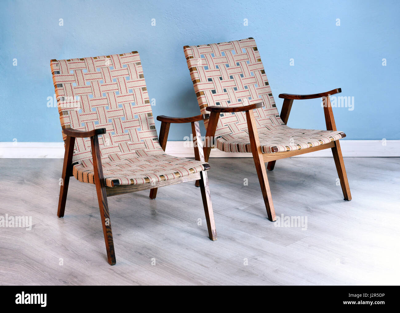 Two Comfortable Wooden Easy Chairs With Woven Strap Upholstery And Stock Photo Alamy