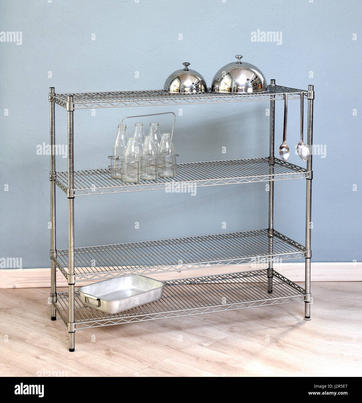 Freestanding iron kitchen shelf with rack design holding two food ...