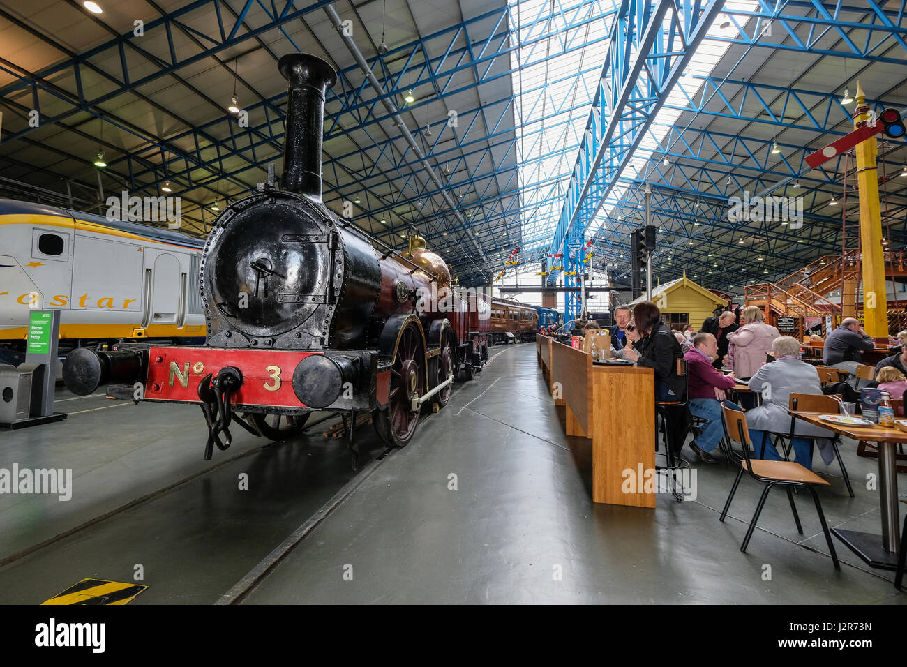 Dining area next to the exhibits inside The National Railway Museum in York - Stock Image