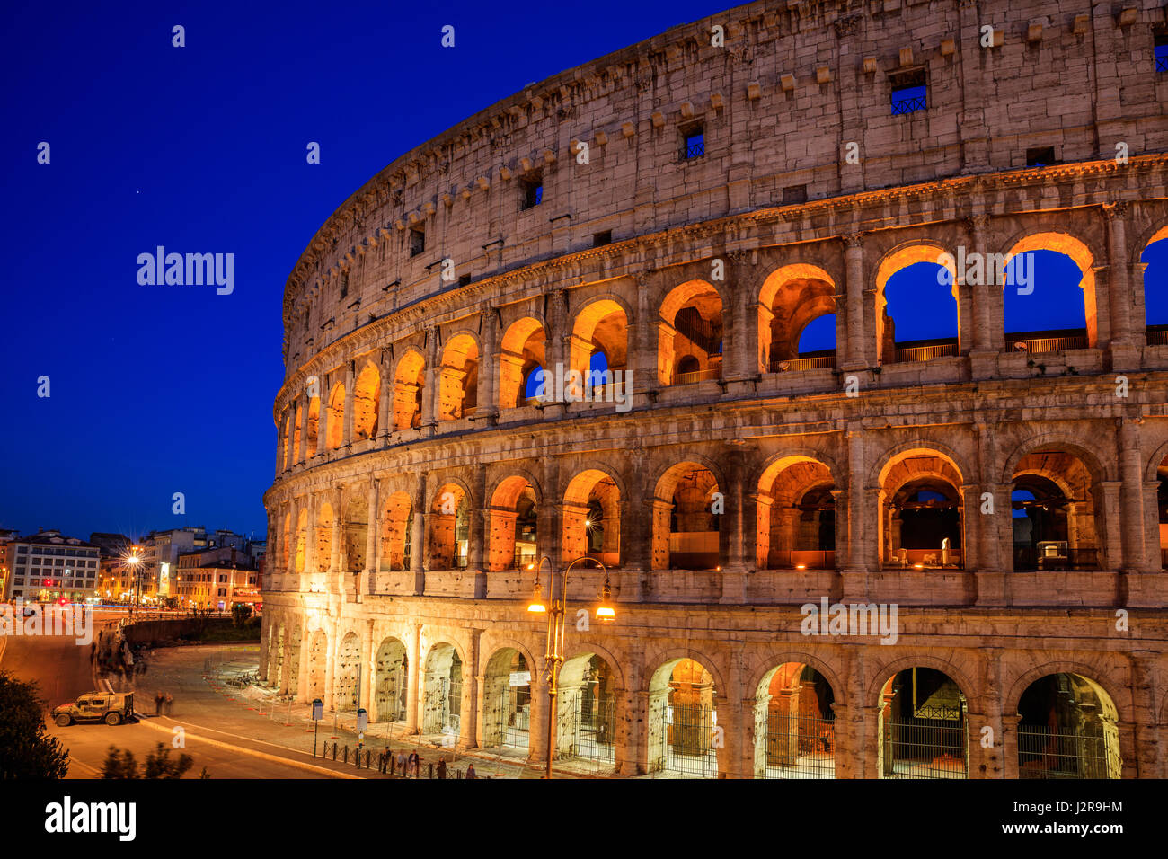 Colosseum view at night in Rome, Italy - Stock Image