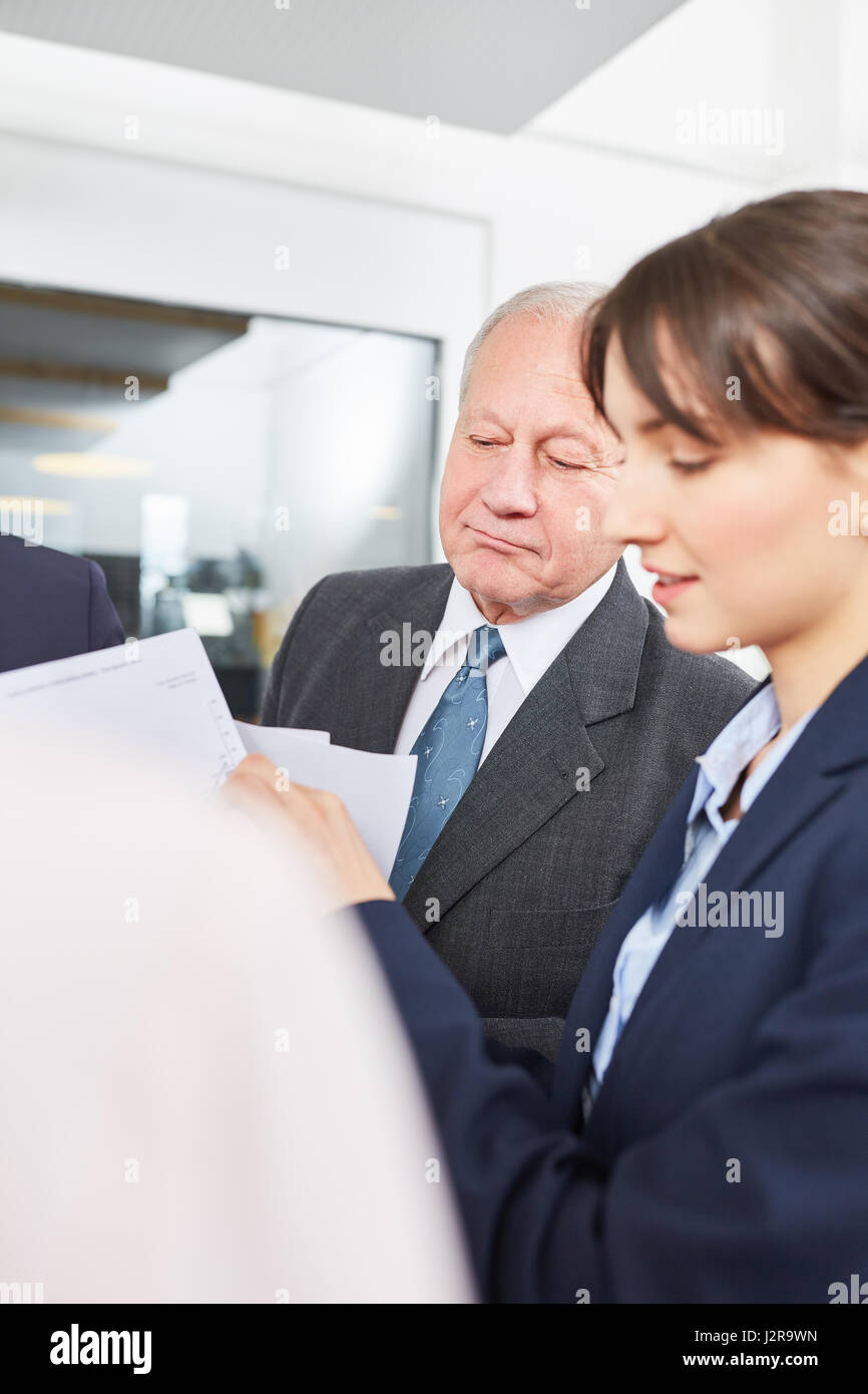 Senior business man and colleague in a meeting planning strategic analysis - Stock Image