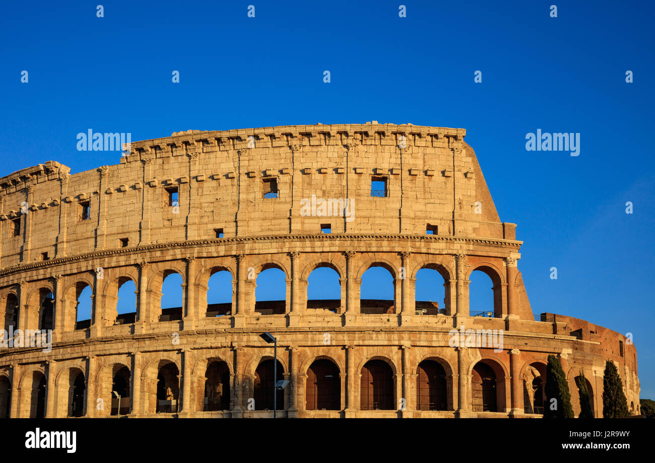 Rome, Italy - Colosseum on blue sky background - Stock Image