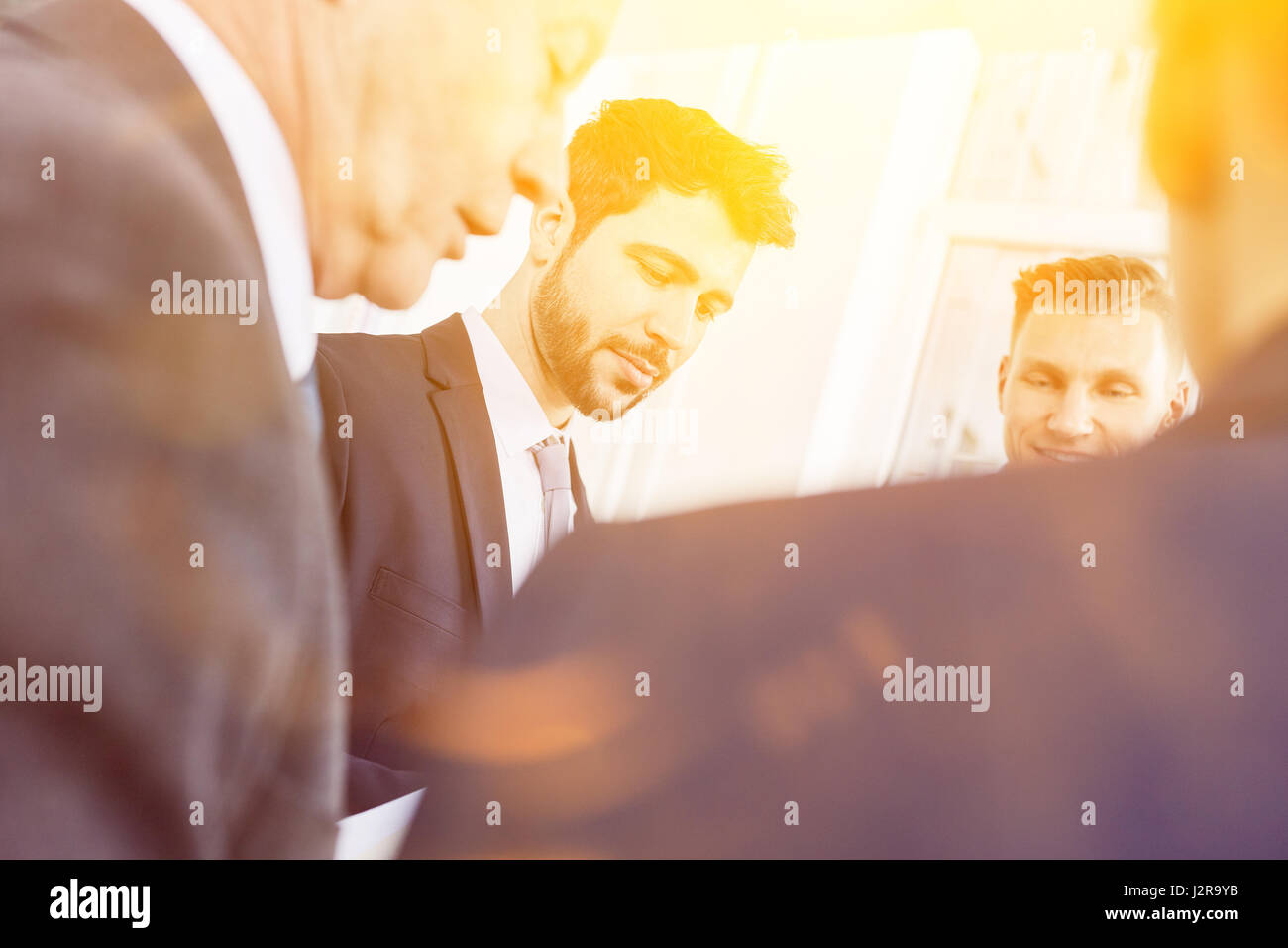 Group of business people talk together in team meeting - Stock Image