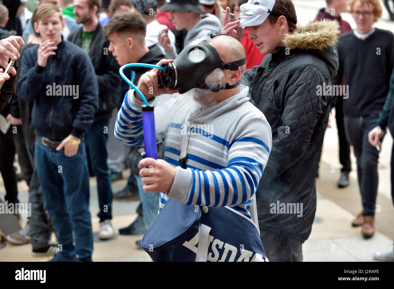 Man inhaling cannabis from weed gas mask bong at a legalise