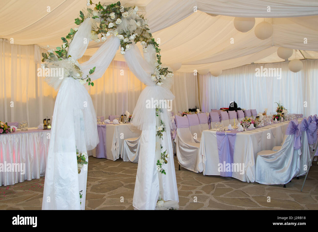 Wedding arch decorated with veil and white roses Stock Photo ...