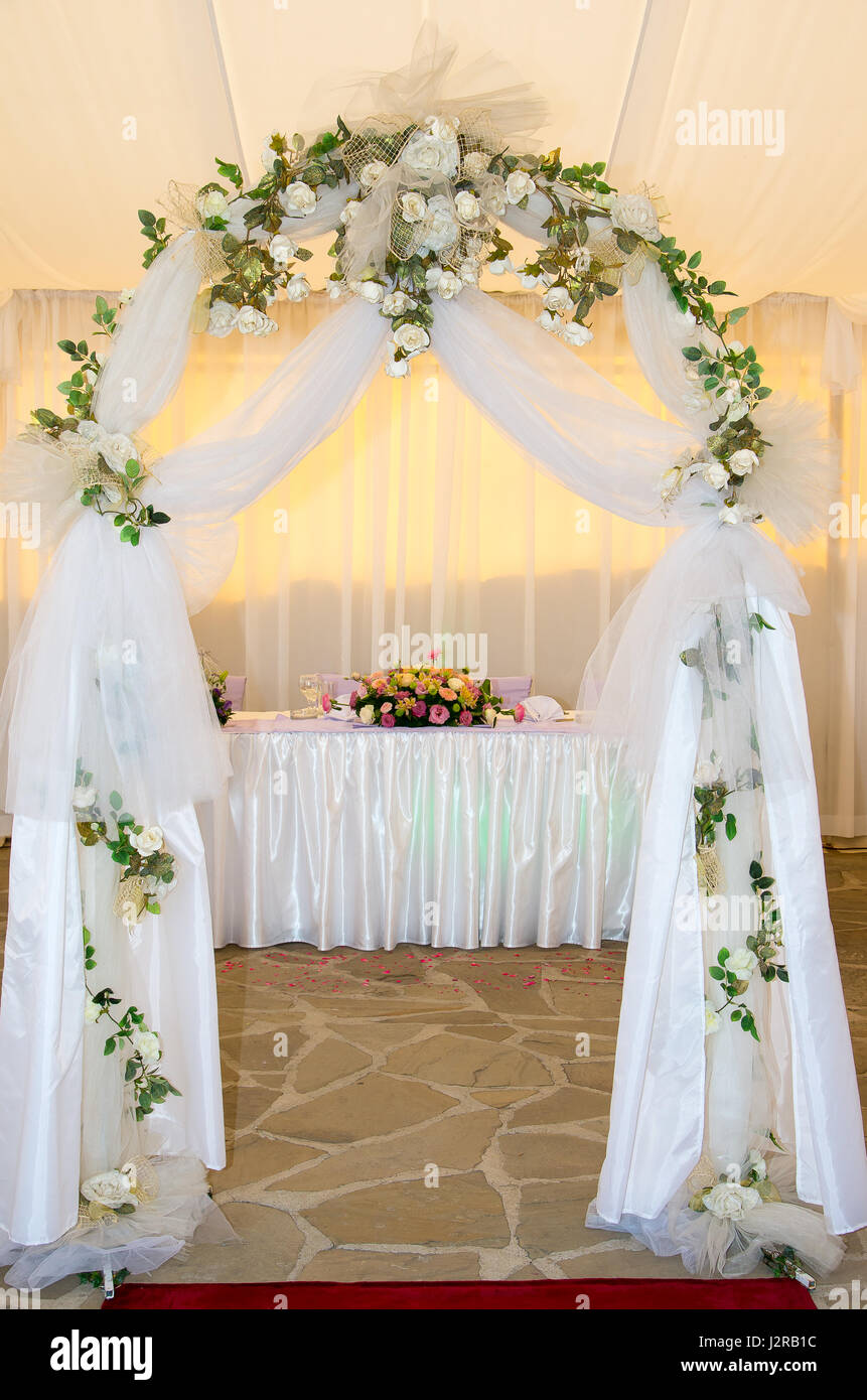 Wedding arch decorated with veil and flowers Stock Photo: 139425816 ...