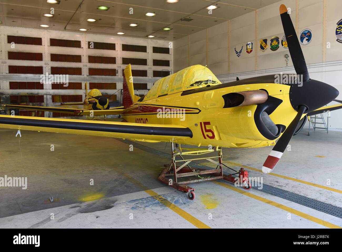 Freshly painted North Carolina Forest Service aviation division T-34C Turbo Mentors sit in the 4th Equipment Maintenance - Stock Image