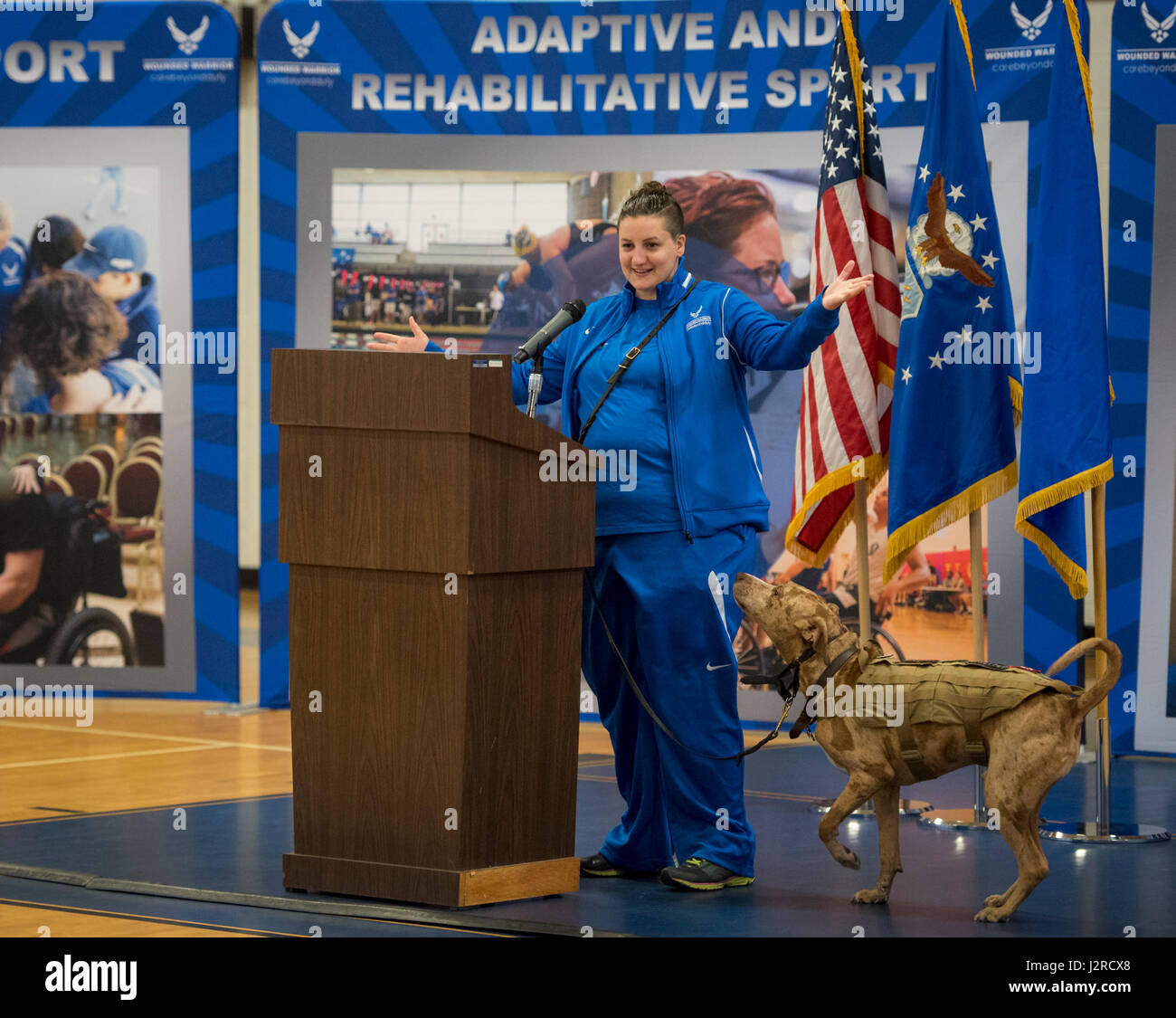 Hanna Stulberg, with her service dog, Valhalla, welcome the Warrior CARE attendees and Warrior Games athletes to - Stock Image