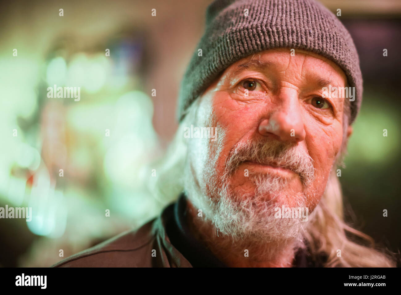 A portrait of a senior adult man looking at the camera. - Stock Image