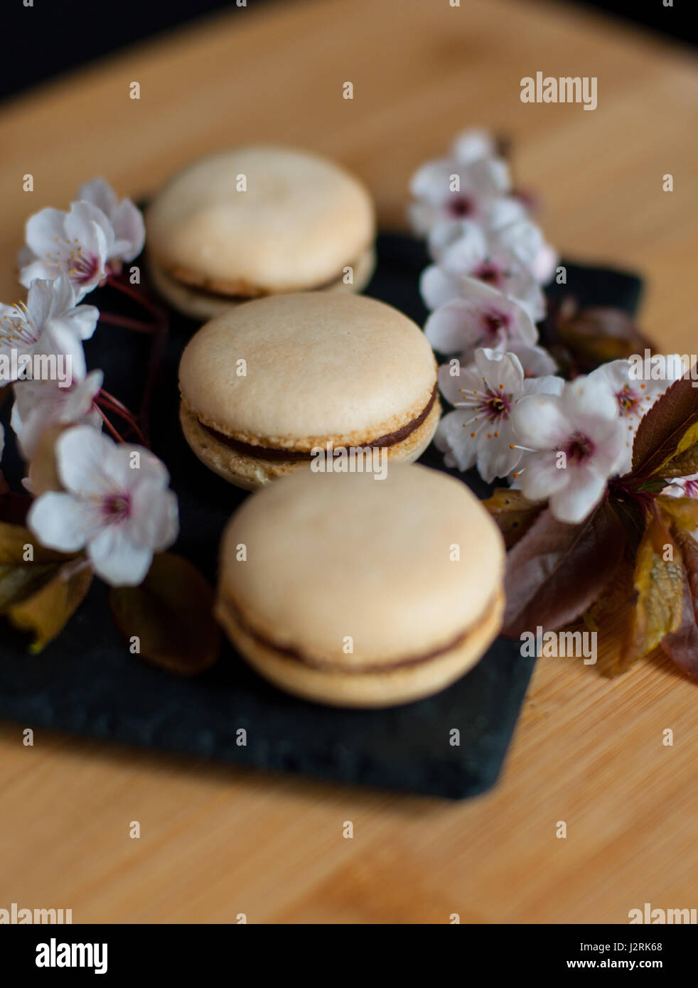 Macaroons decorated with flowers - Stock Image