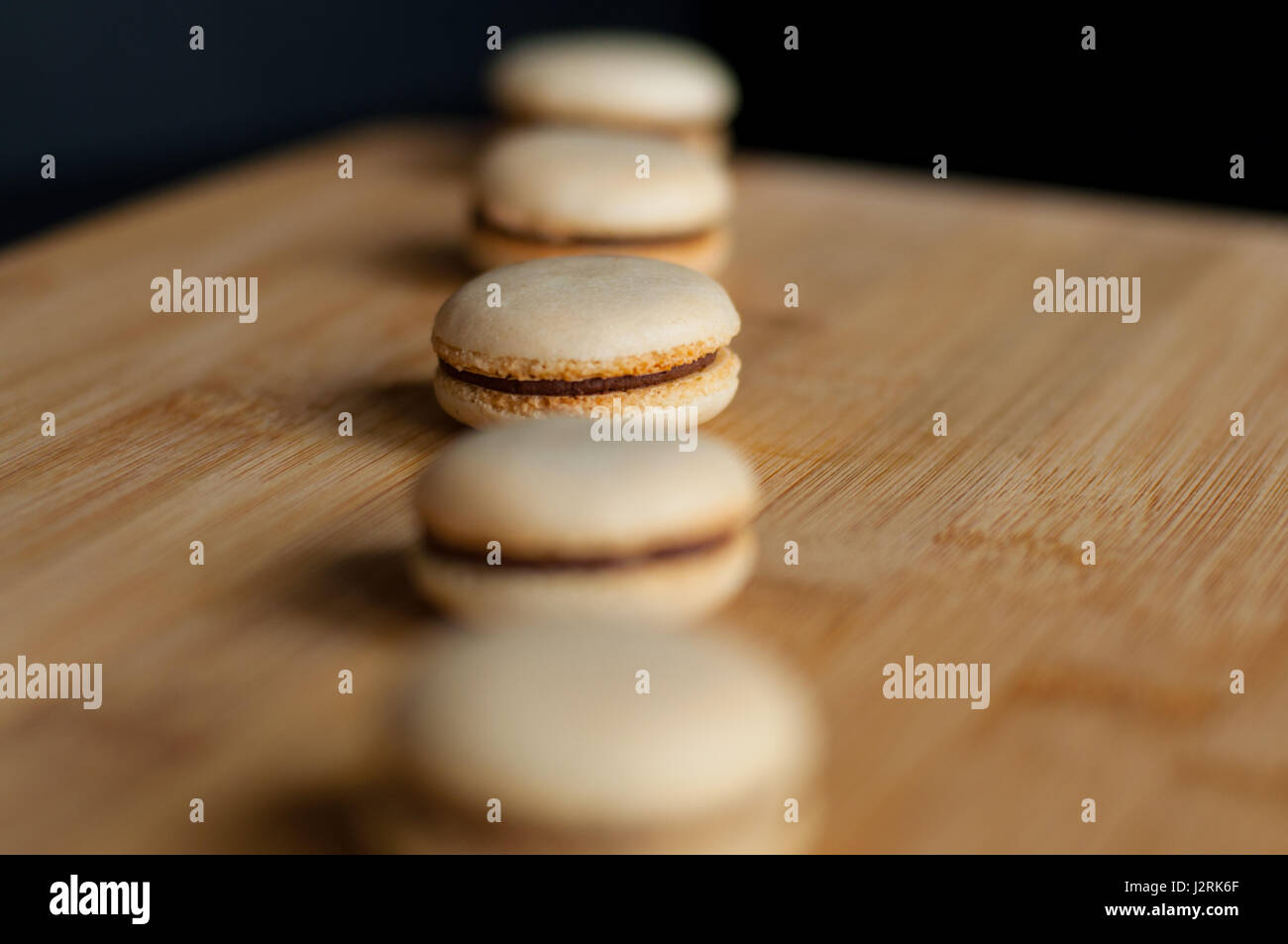 Macaroons organized in straight line - Stock Image