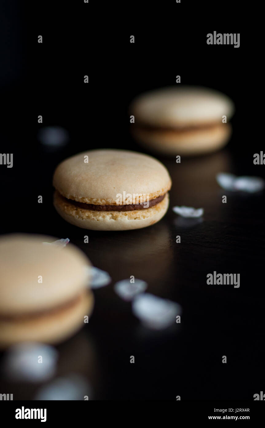 Macaroons with chocolate cream decorated with pebbles - Stock Image