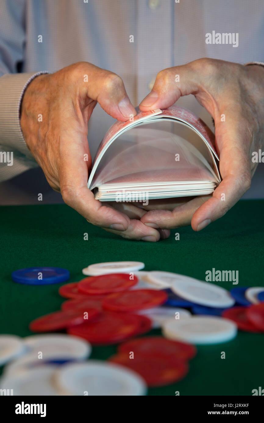 man Shuffling Cards Dealing at Poker Game - Stock Image