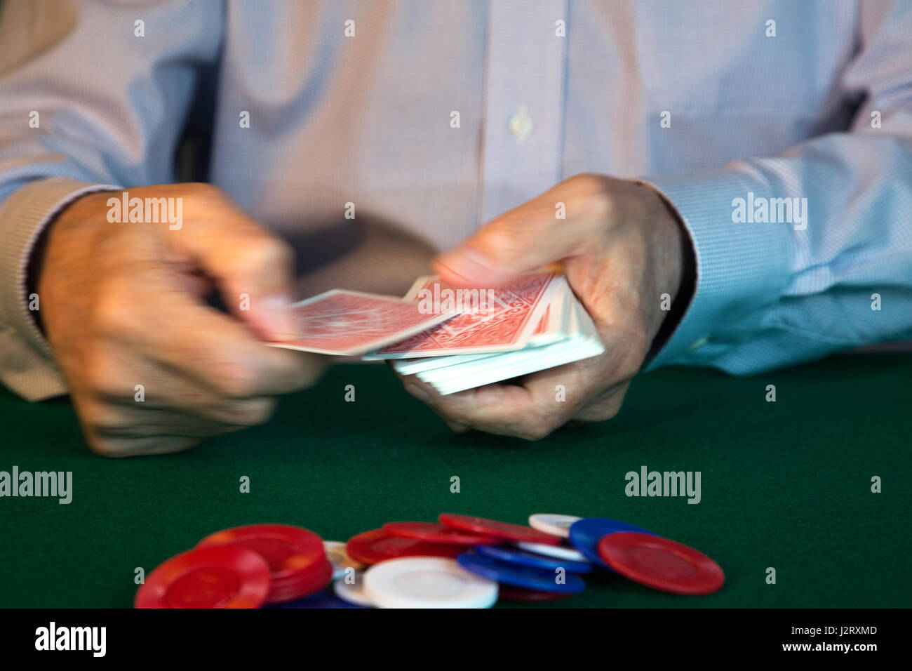 Man Dealing Cards for Poker Game - Stock Image
