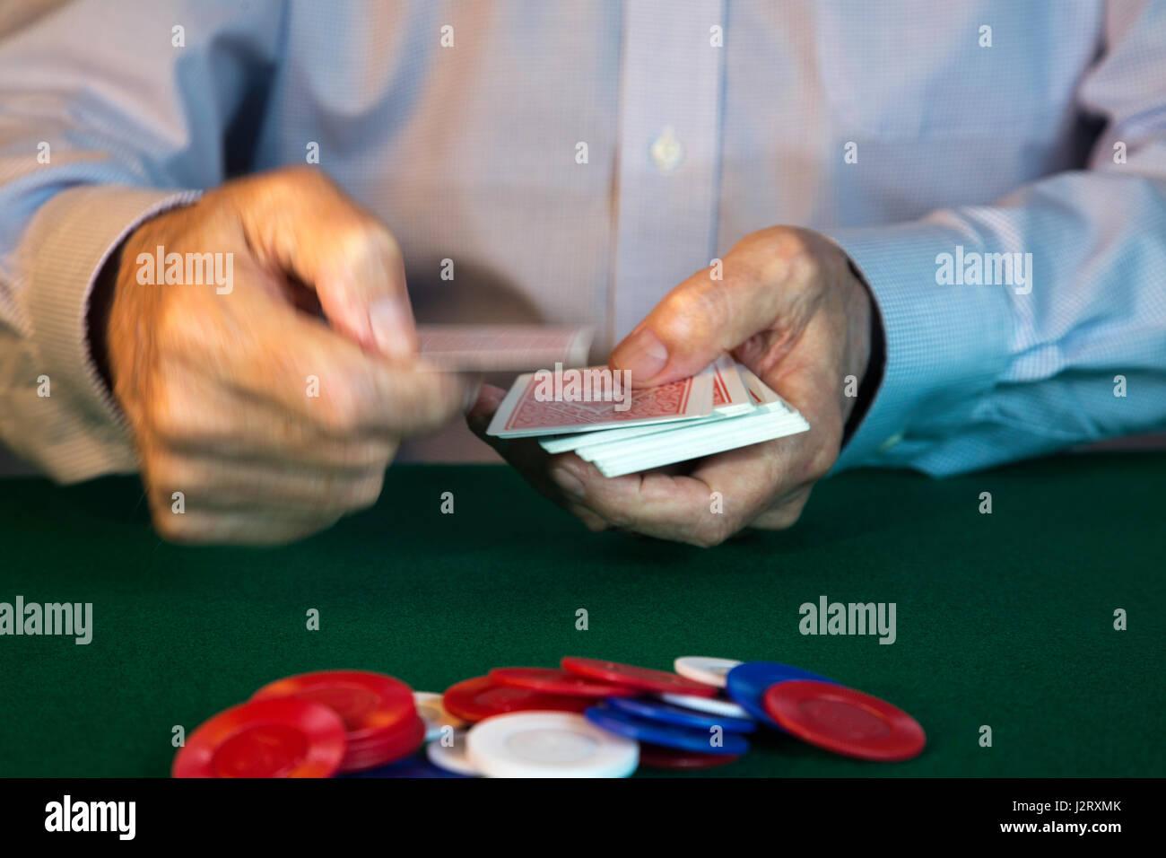 Man Dealing Cards at Poker Game - Stock Image