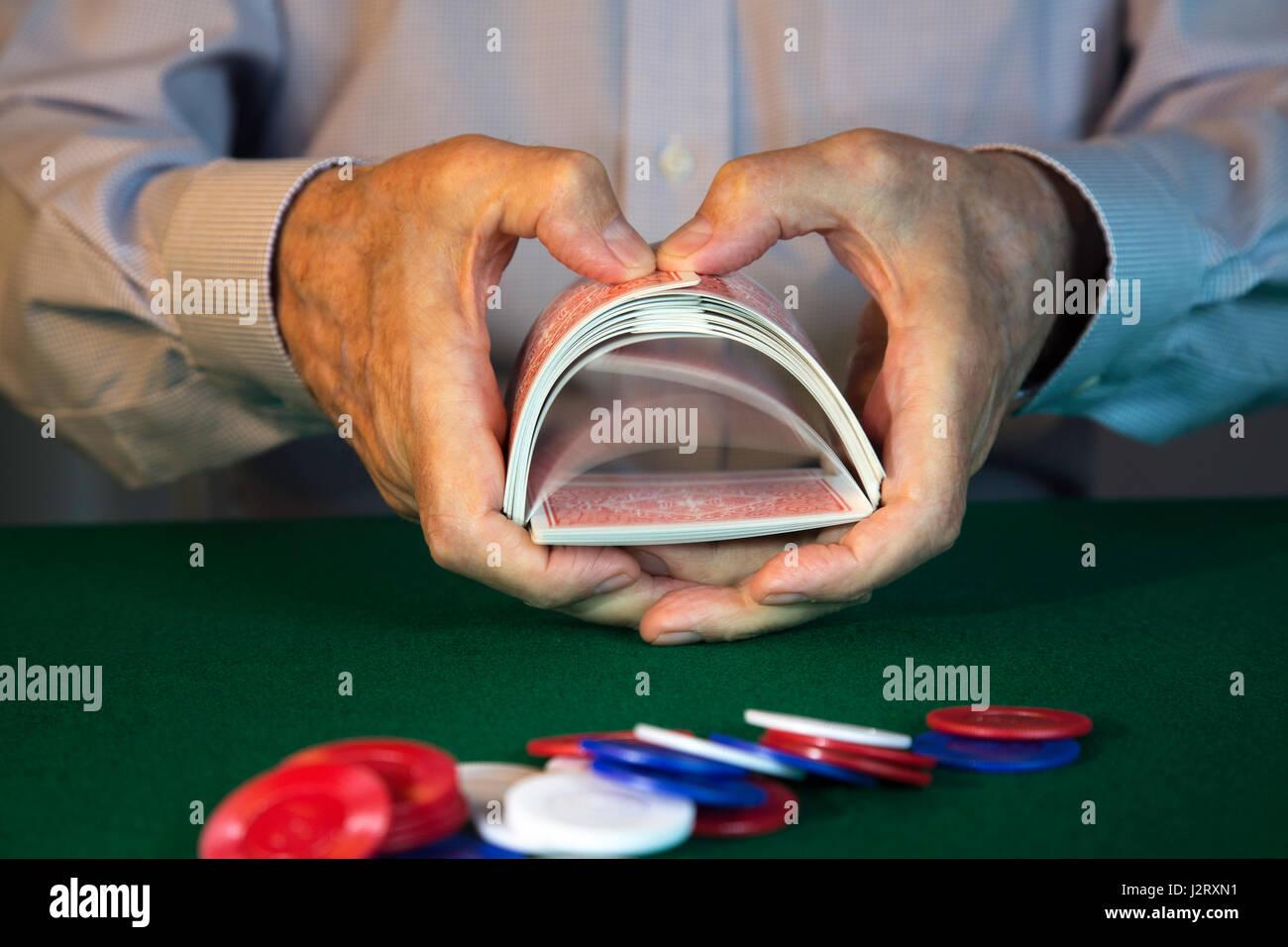 man Shuffling Cards Dealing at Poker Game Stock Photo