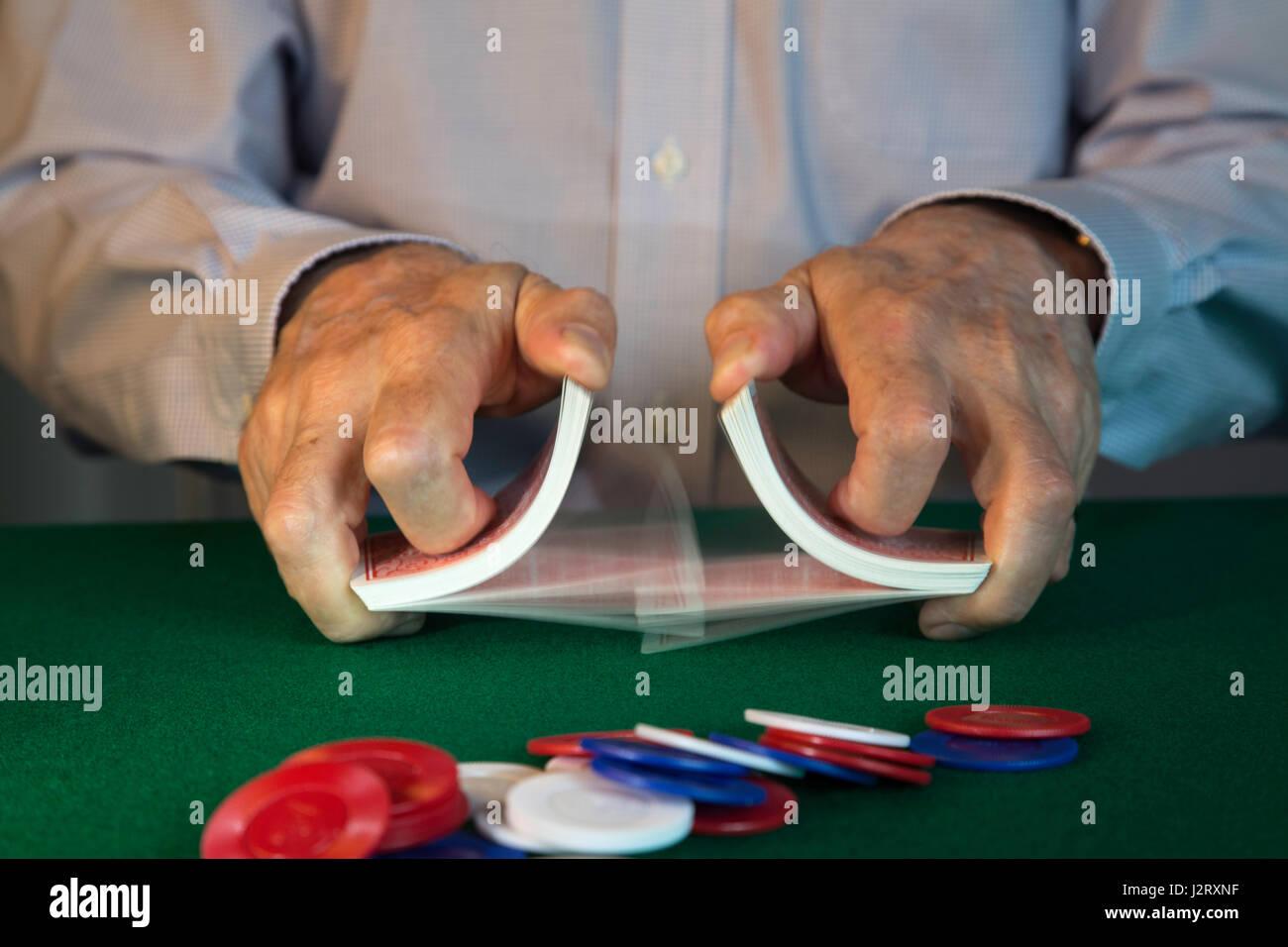 Man Shuffling Cards Dealing at Poker Game, USA - Stock Image