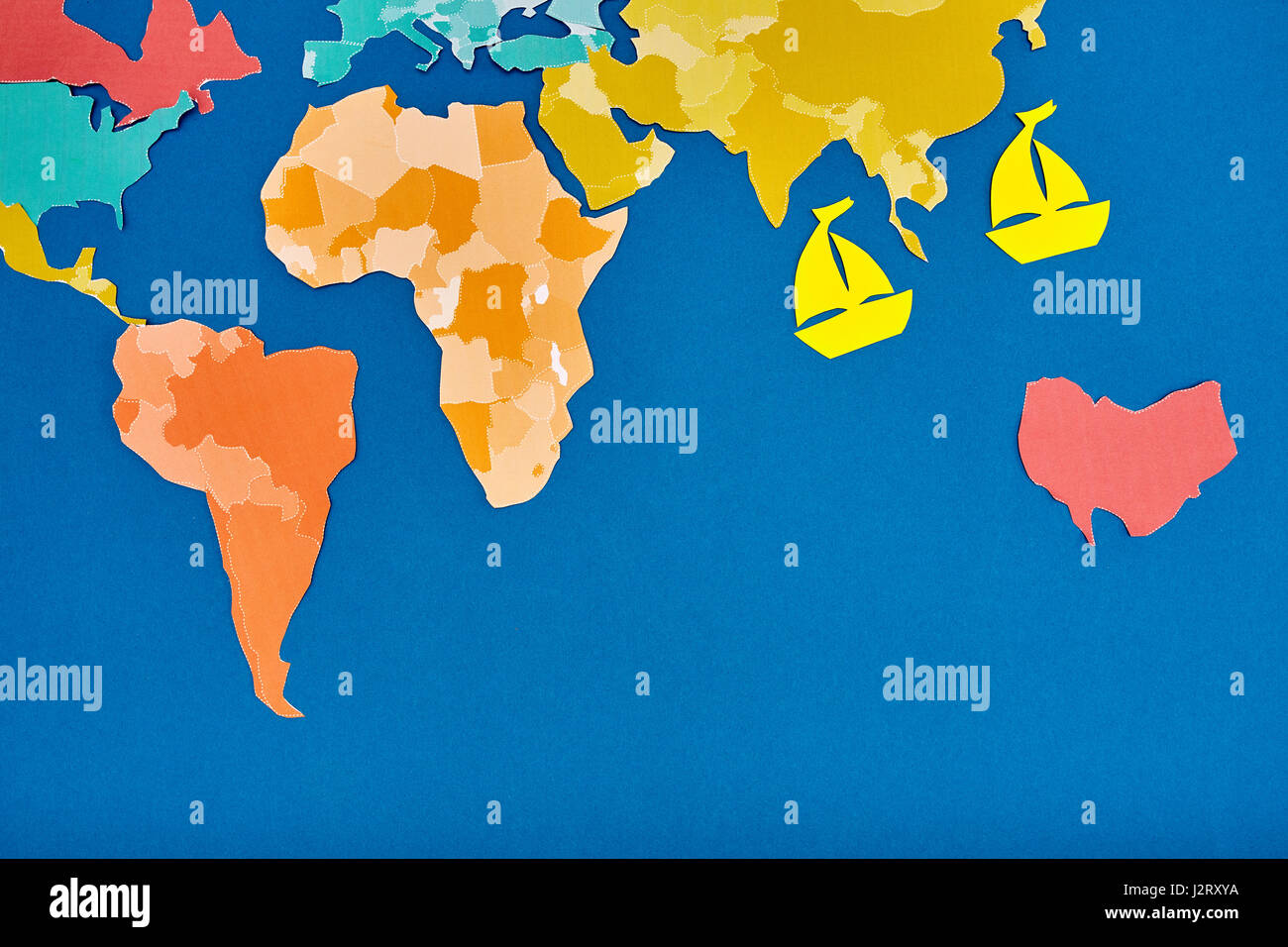 World map and two ships cut out of colored paper based on blue stock world map and two ships cut out of colored paper based on blue applique and handmade continents and oceans trip around the world concept of the tr gumiabroncs Image collections