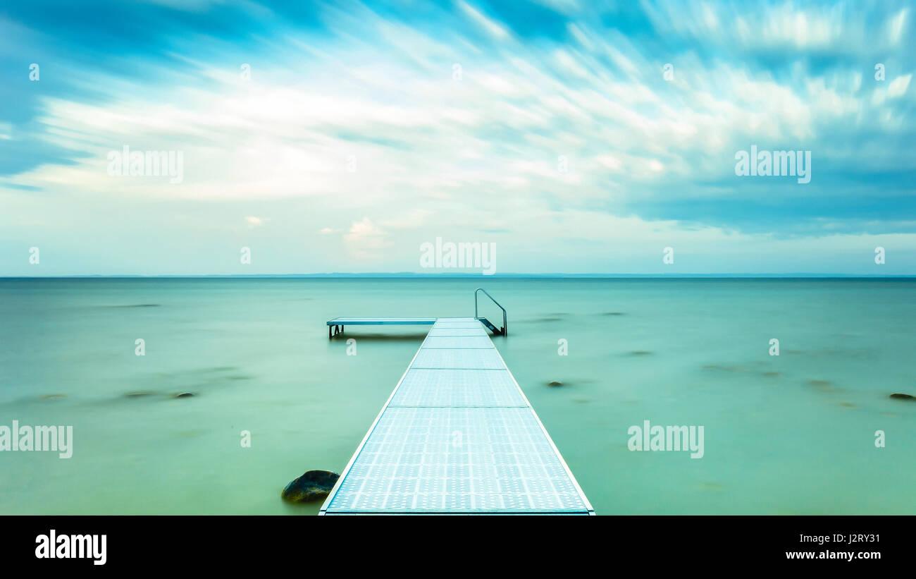 Pier in ocean Stock Photo
