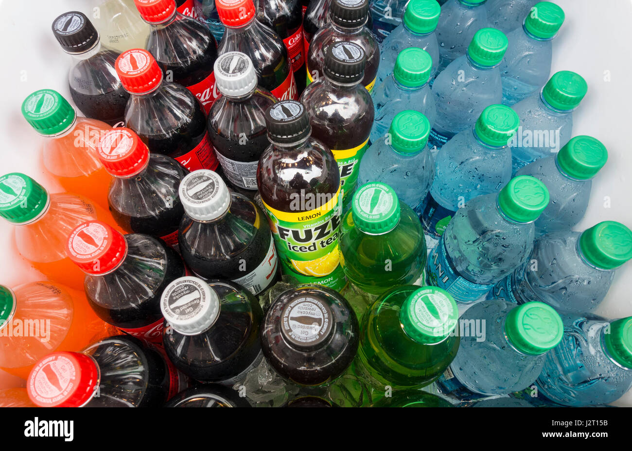 A selection of soft drinks in a cooler, including ice tea - Stock Image