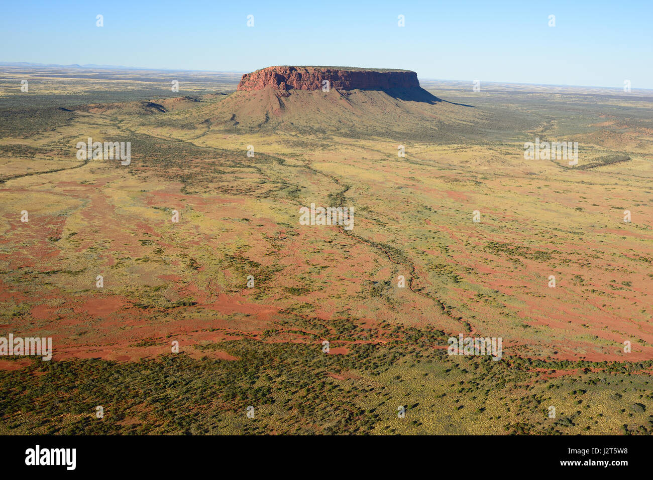 MOUNT CONNER; AN ISOLATED MESA (OR INSELBERG) IN THE RED CENTER OF AUSTRALIA (aerial view). Northern Territory, - Stock Image