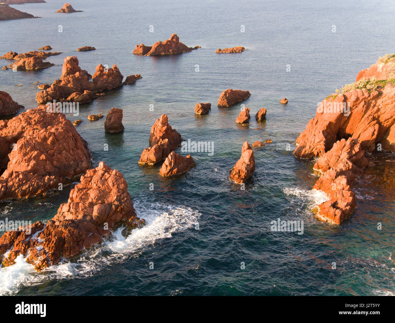 NUMEROUS SEA PINNACLES OFF THE COAST OF THE ESTEREL MASSIF (aerial view). Saint-Raphaël, Var, French Riviera, - Stock Image