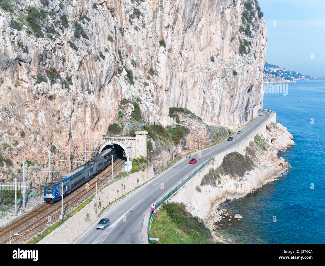 RAILROAD AND ROAD IN A TOPOGRAPHICALLY UNFRIENDLY REGION (aerial view). Between Beaulieu-sur-Mer and Eze Bord de - Stock Image