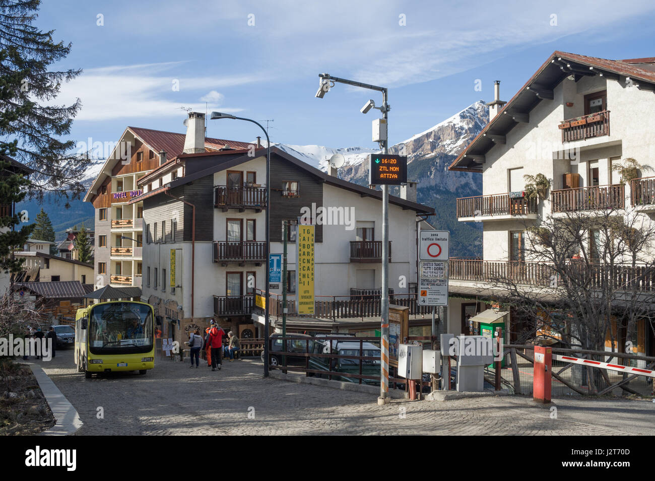 A local bus and accomodation in Sauze d'Oulx ski resort, Turin, Piedmont, Italy - Stock Image
