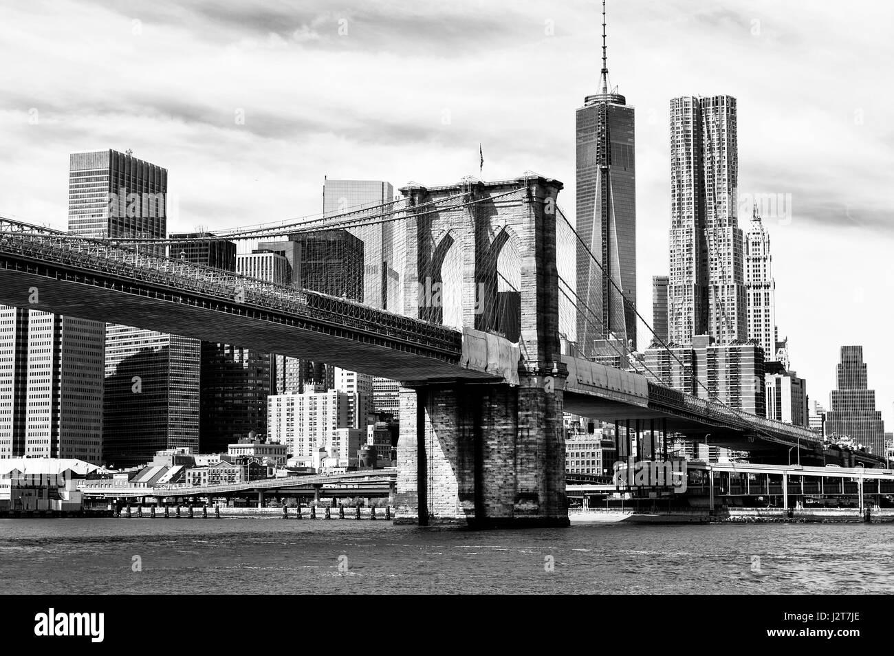 The Manhattan skyline and Brooklyn Bridge at night seen from Brooklyn Bridge Park in Brooklyn, New York. Stock Photo