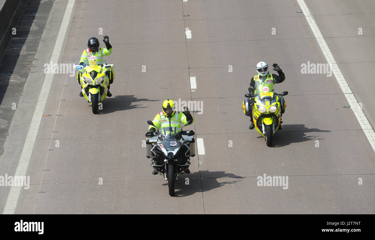 WAVING MOTORCYCLISTS WEARING HIGH VISIBILITY CLOTHING ON M54 MOTORWAY RE BE SAFE BE SEEN MOTORBIKES SAFETY FRIENDLY - Stock Image