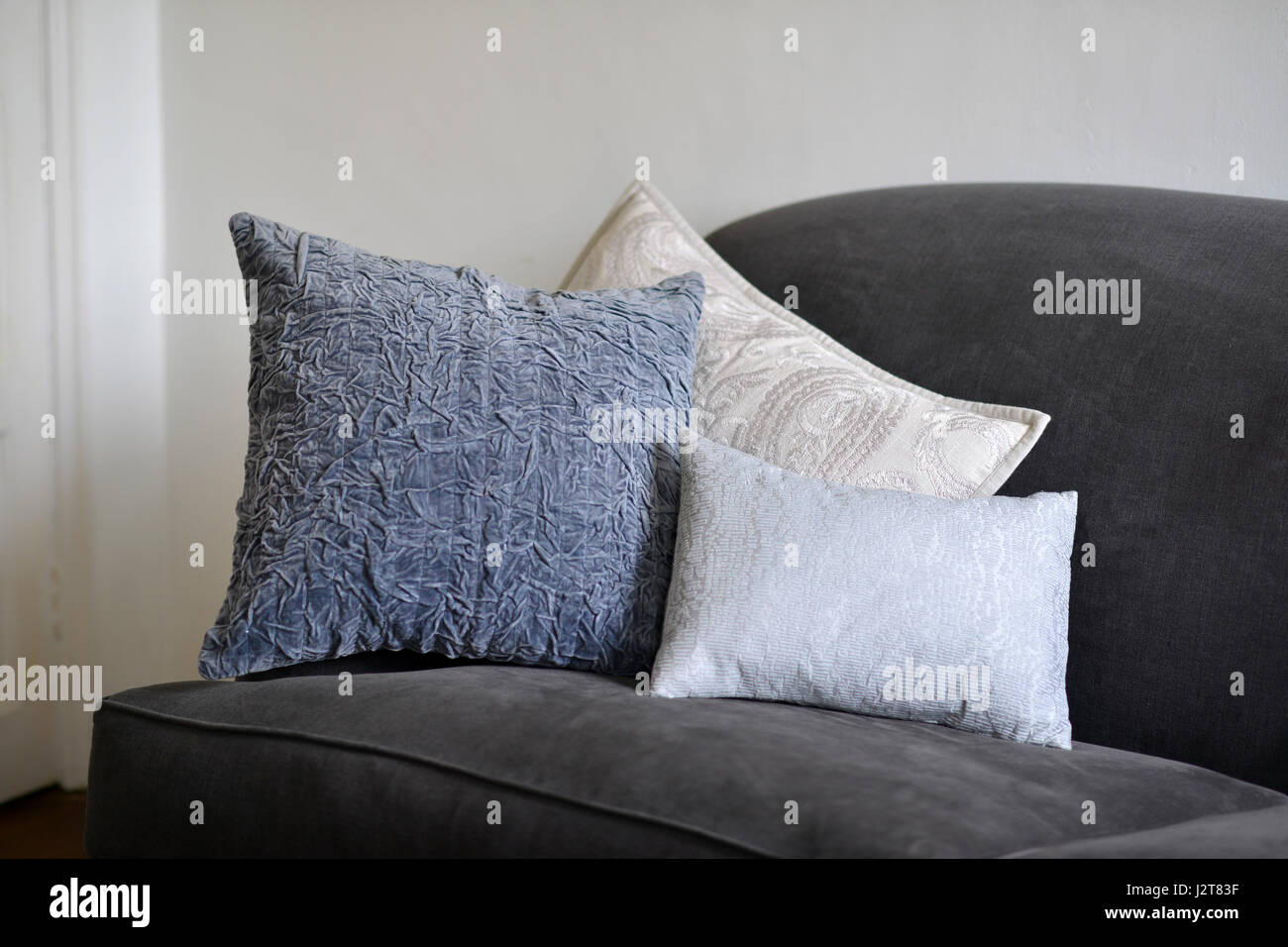 Textured cushions on a couch - Stock Image