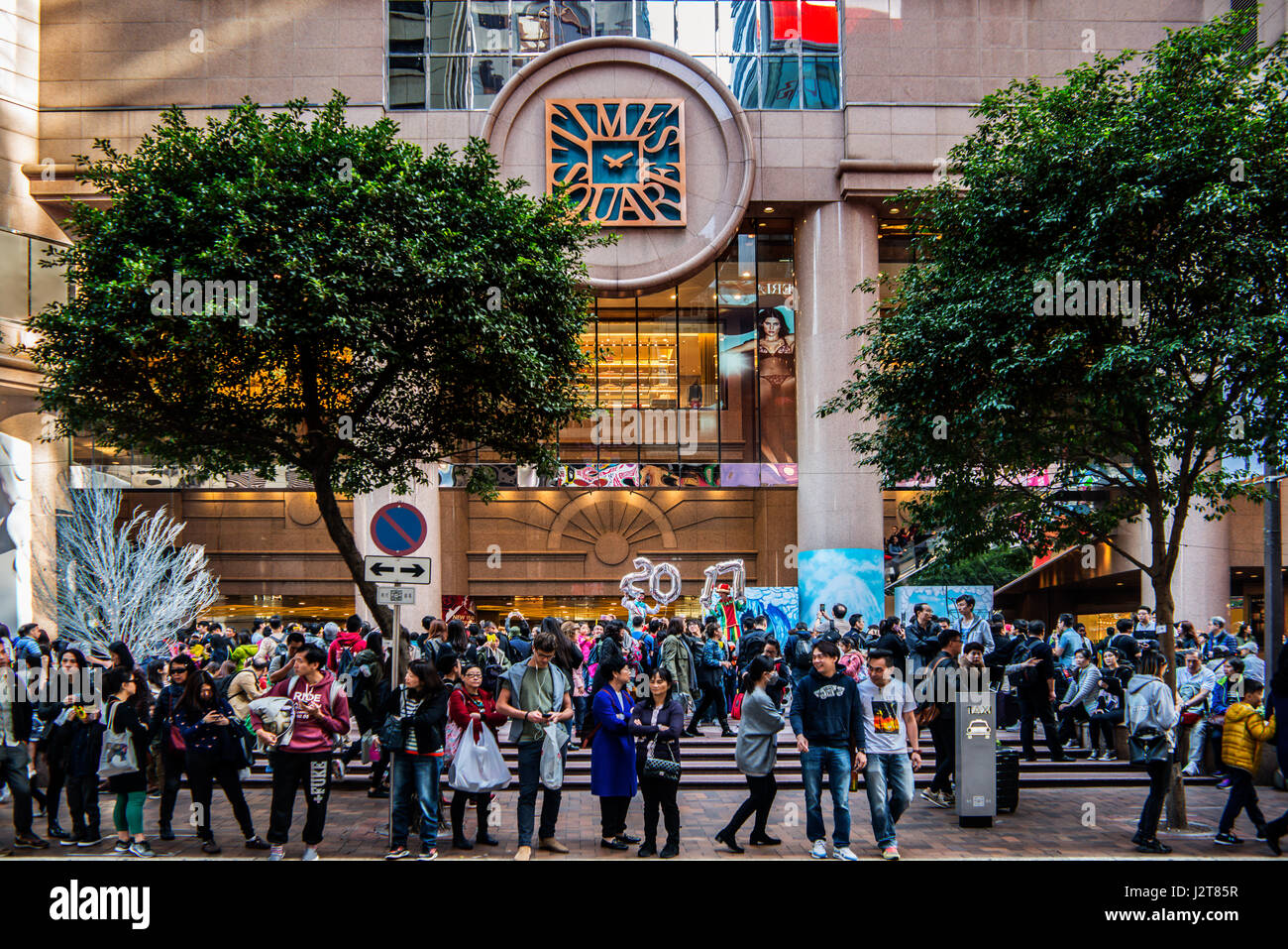 Times Square, Causeway Bay, Hong Kong with Entertainers and taxi rank - Stock Image