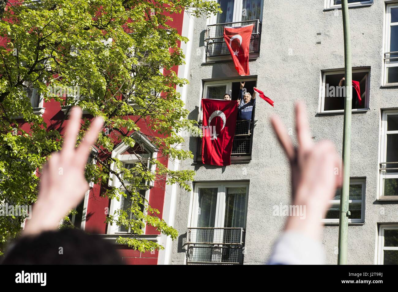 Berlin, Berlin, Germany. 30th Apr, 2017. Turkish people react as few hundred demonstrators pass by during a demonstration - Stock Image