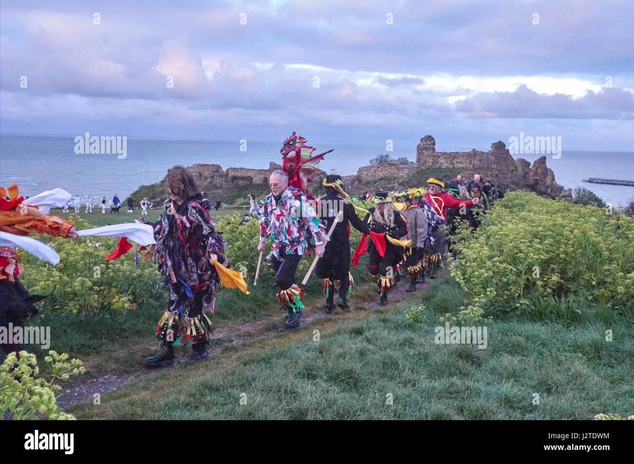 Hastings, East Sussex, UK. 1st May 2017. Revellers and spectators join the Morris Dancers by Hastings Castle at - Stock Image