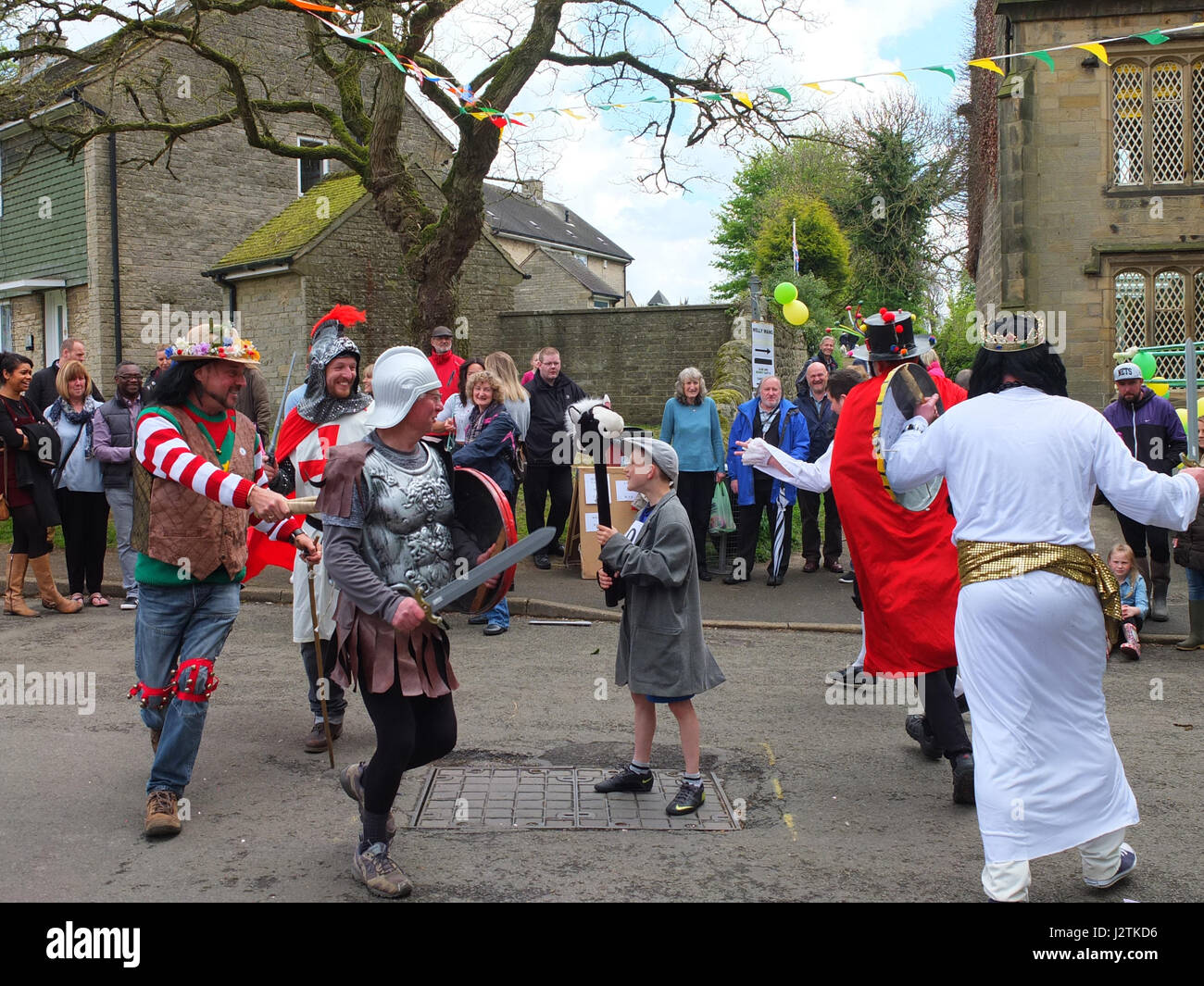 Annual May Day carnival at the village of  Ashover, near Chesterfield, Derbyshire. Mummers play being performed Stock Photo