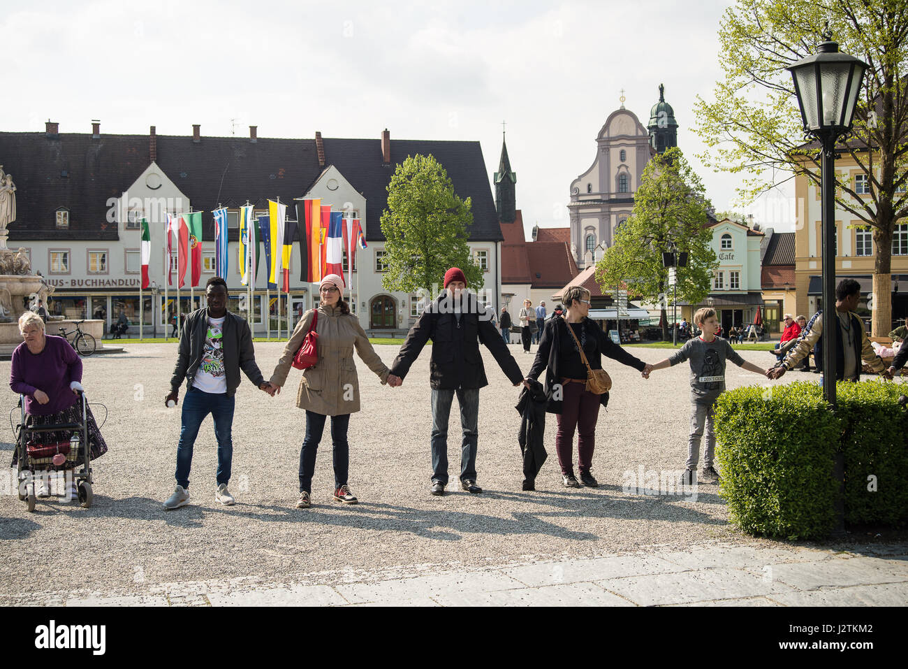 Altoetting, Germany-May 1, 2017: People protesting against the European Union's refugee policy form a human - Stock Image