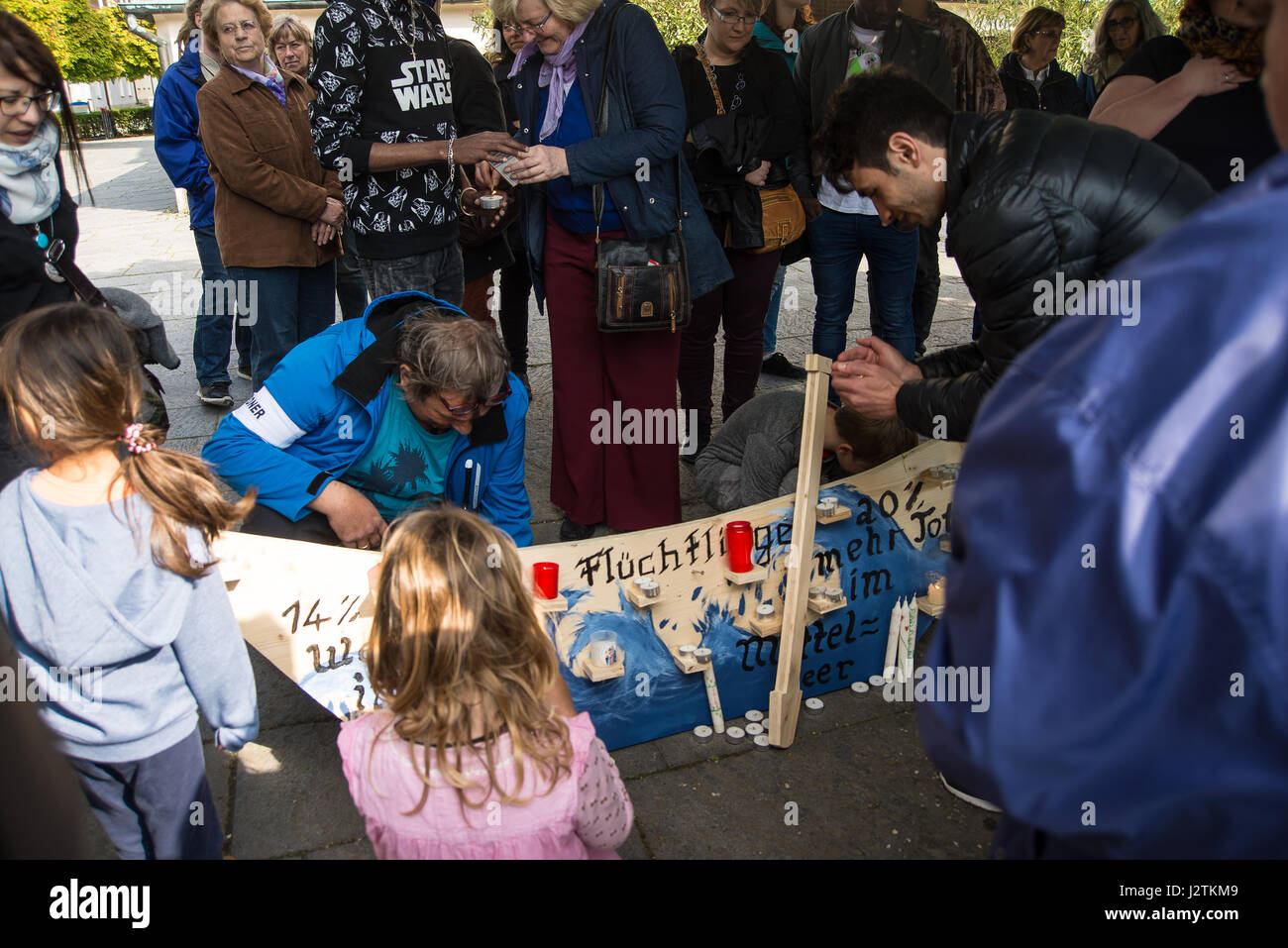 Altoetting, Germany-May 1, 2017: People protesting against the European Union's refugee policy light candles - Stock Image