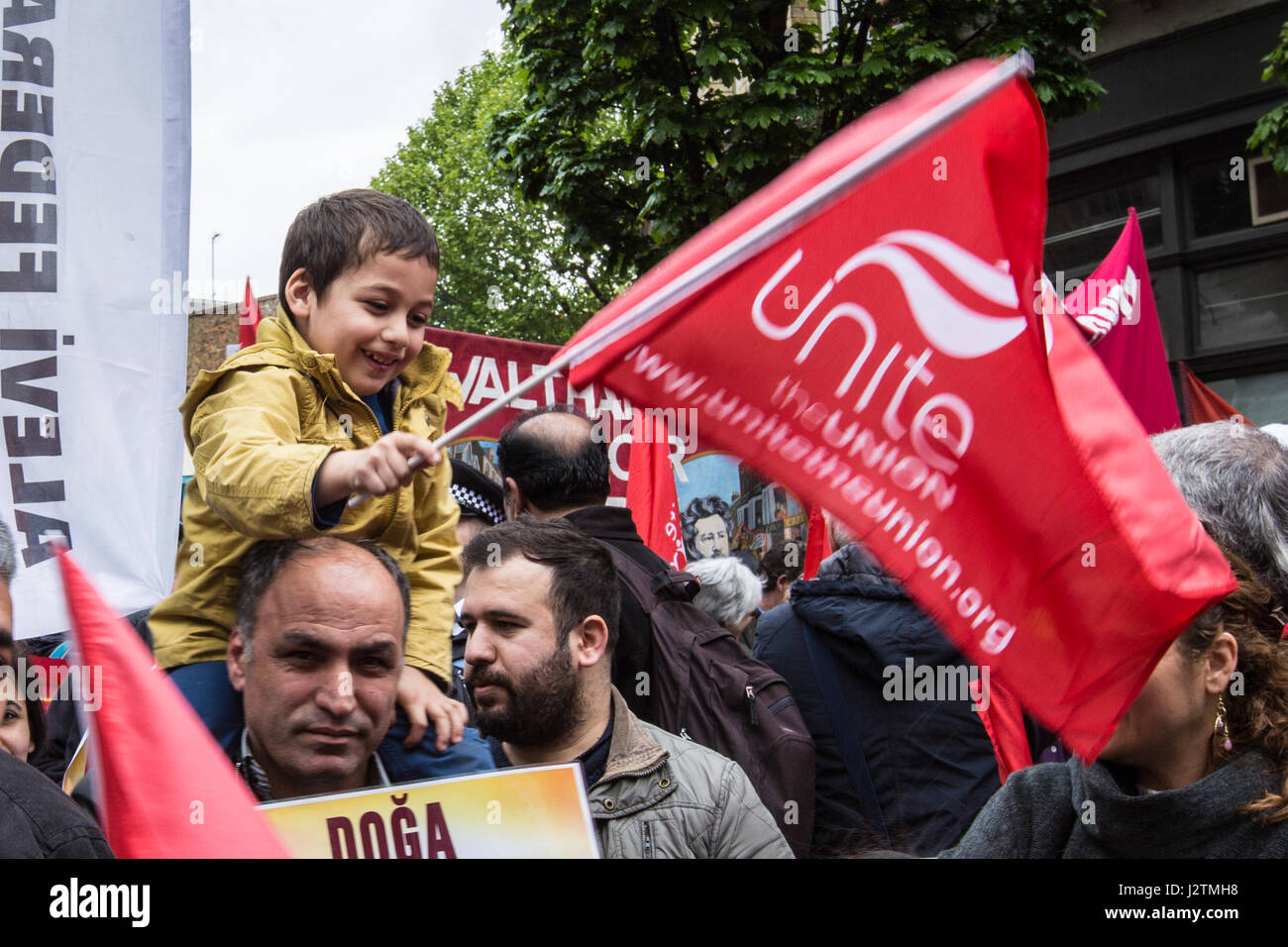 London, UK. 1st May, 2017.  A boy waves a union flag on the traditional May Day workers march from Clerkenwell Green - Stock Image