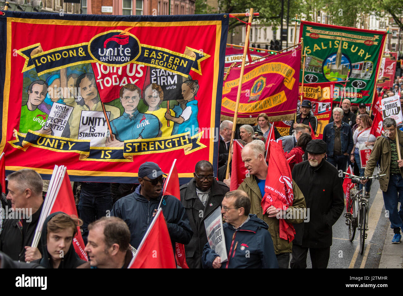 London, UK. 1st May, 2017. Colourful union banners on the traditional May Day workers march from Clerkenwell Green - Stock Image