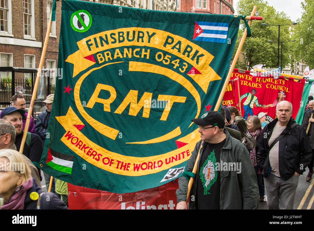 London, UK. 1st May, 2017. 'Workers of the World unite' an RMT union banner on the traditional May Day workers - Stock Image