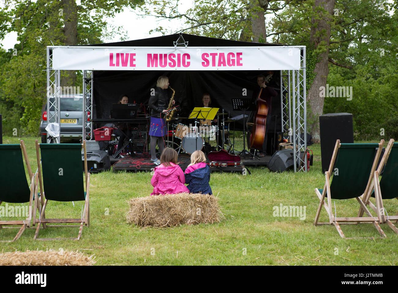 Mapledurham, Oxfordshire, UK . 1st May, 2017.  two young girls enjoying the  Live Music Stage at Mapledurham food - Stock Image