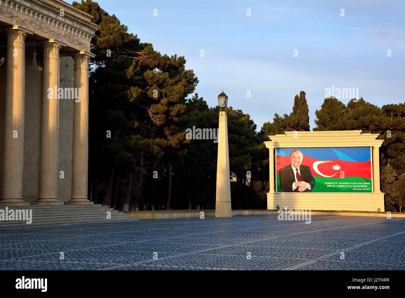 Heydar Aliyev in front of Azerbaijani flag on poster. Photograph of former President of Azerbaijan displayed in Stock Photo