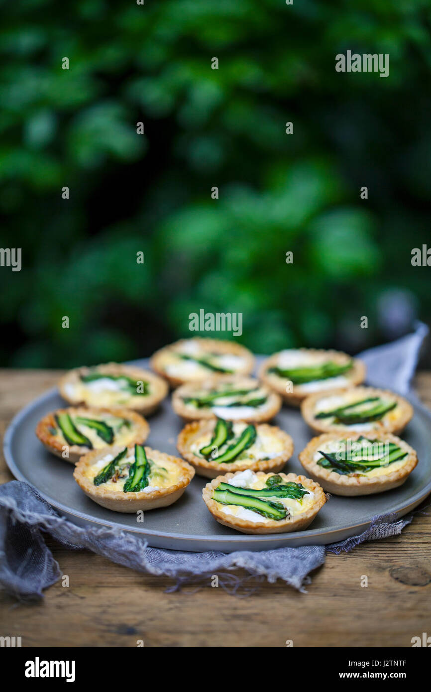 Asparagus and goat cheese tartlets - Stock Image
