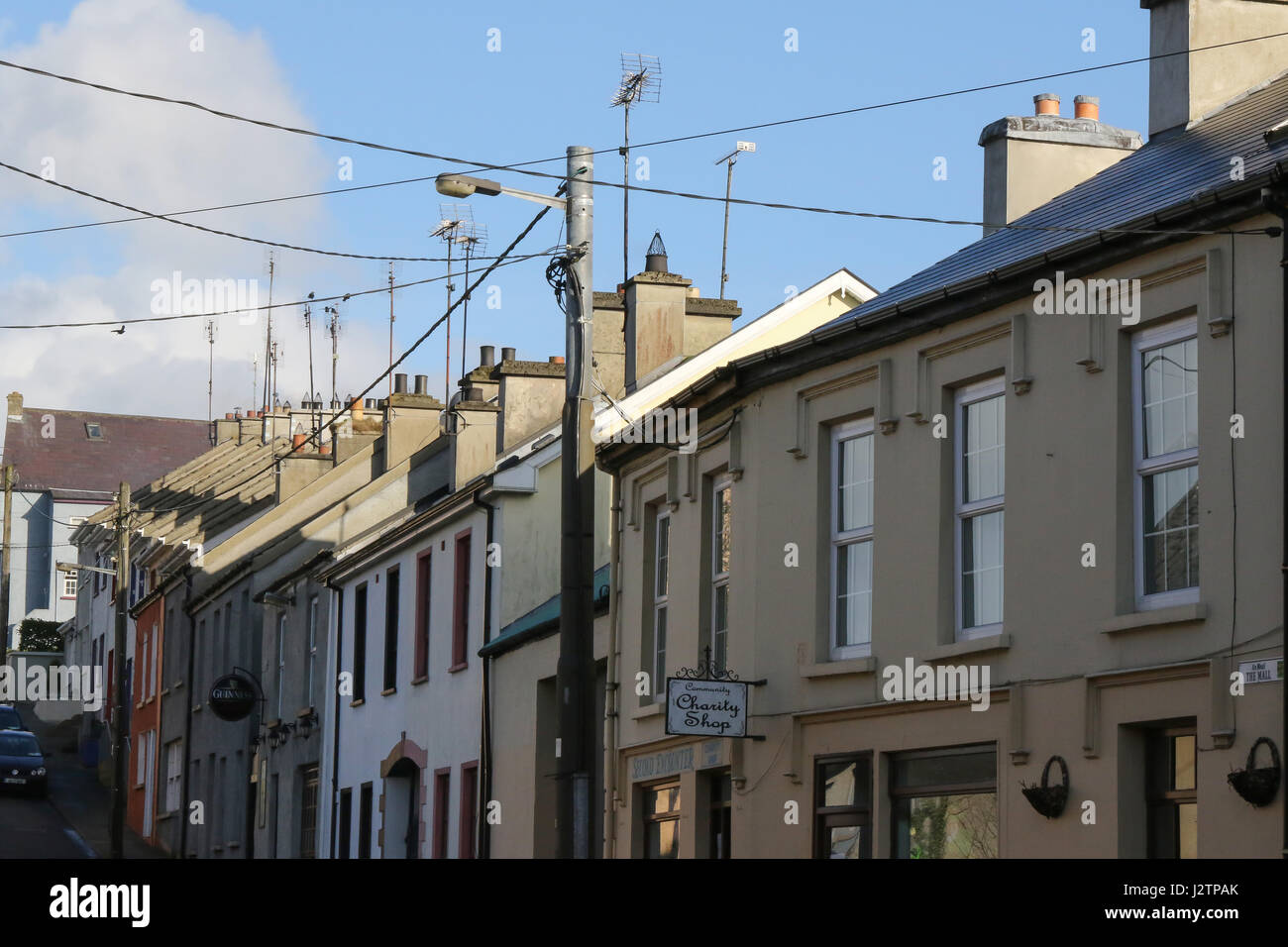 Chimneys and aerials on row of terrace houses in Ramelton, County Donegal, Ireland. - Stock Image