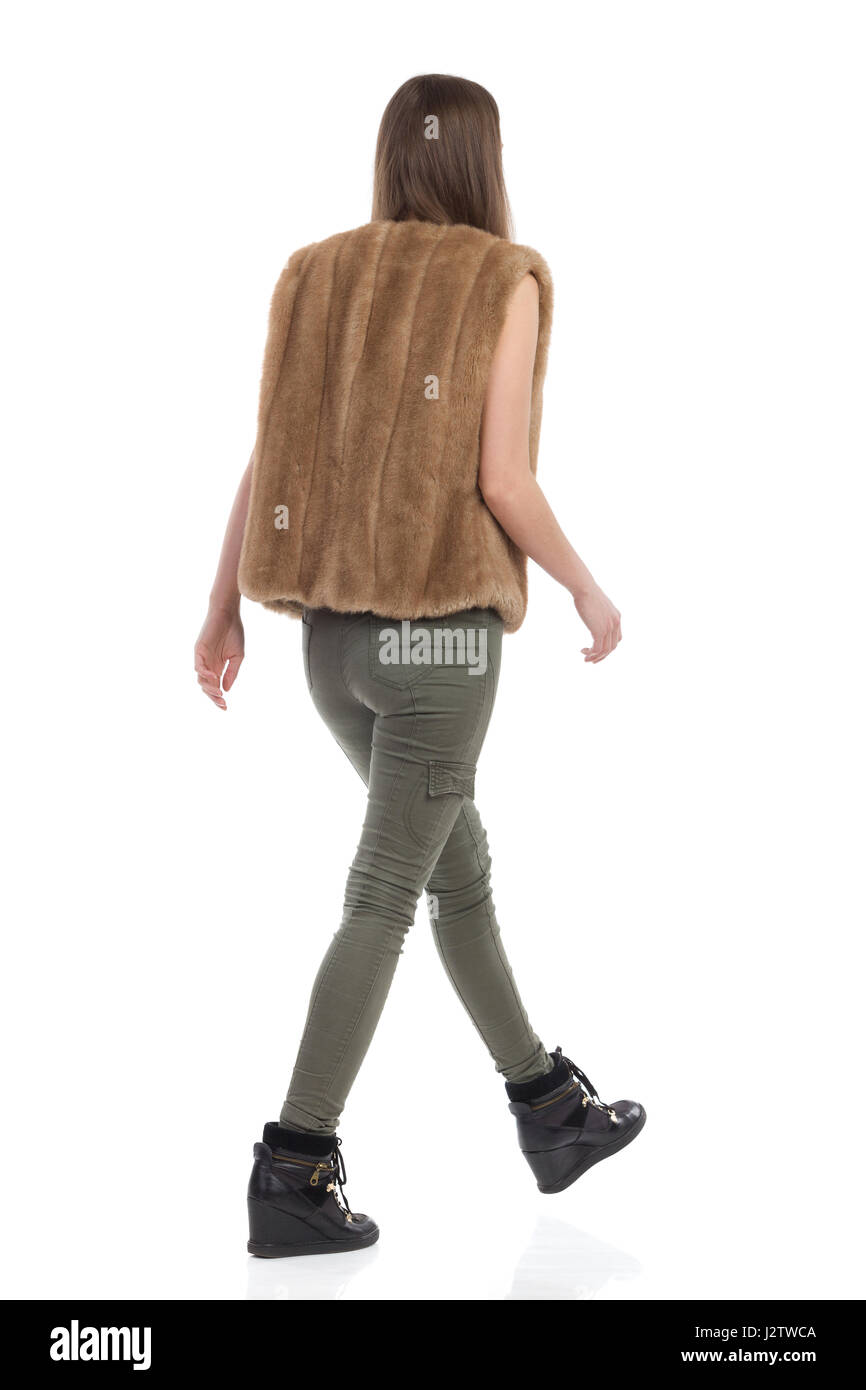 Marching Girl Cut Out Stock Images Pictures Alamy Pants Black Woman In Brown Fur Waistcoat Khaki And Boots Walking Rear View