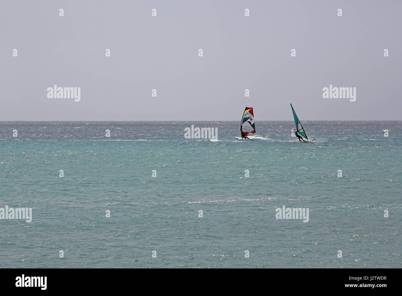 Pair of windsurfers - Stock Image