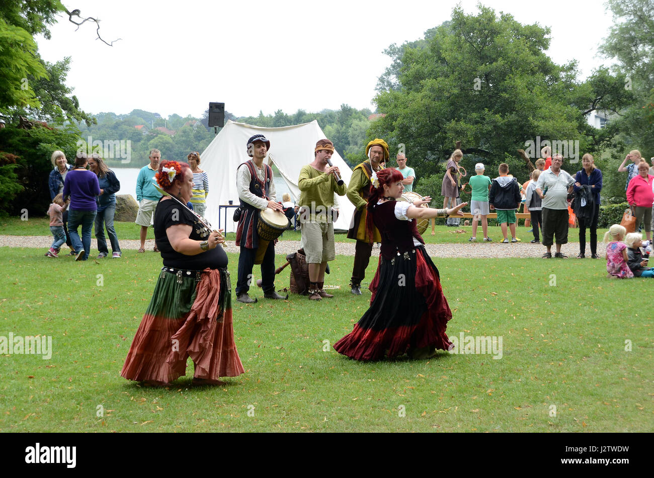 Nordborg, Denmark - August 10, 2013: Middel Age festival at the lake, dancers and musicians show ancient music and Stock Photo